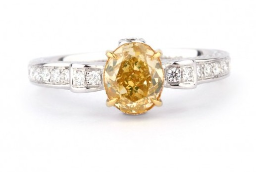 gorgeous Fancy Intense Yellow oval pave Diamond Ring, 1.07 ct, with diamonds around it