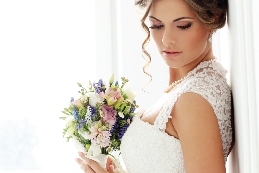 bride with colored flowers