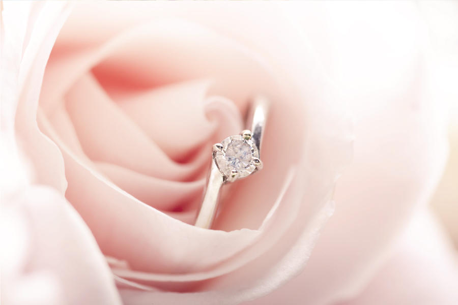 A wedding ring in a rose