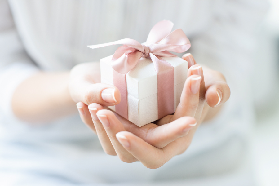 A girl holds a gift box