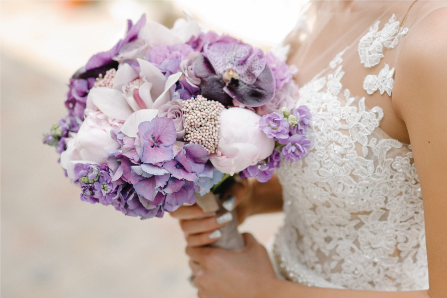 Bride with a purple bouquet