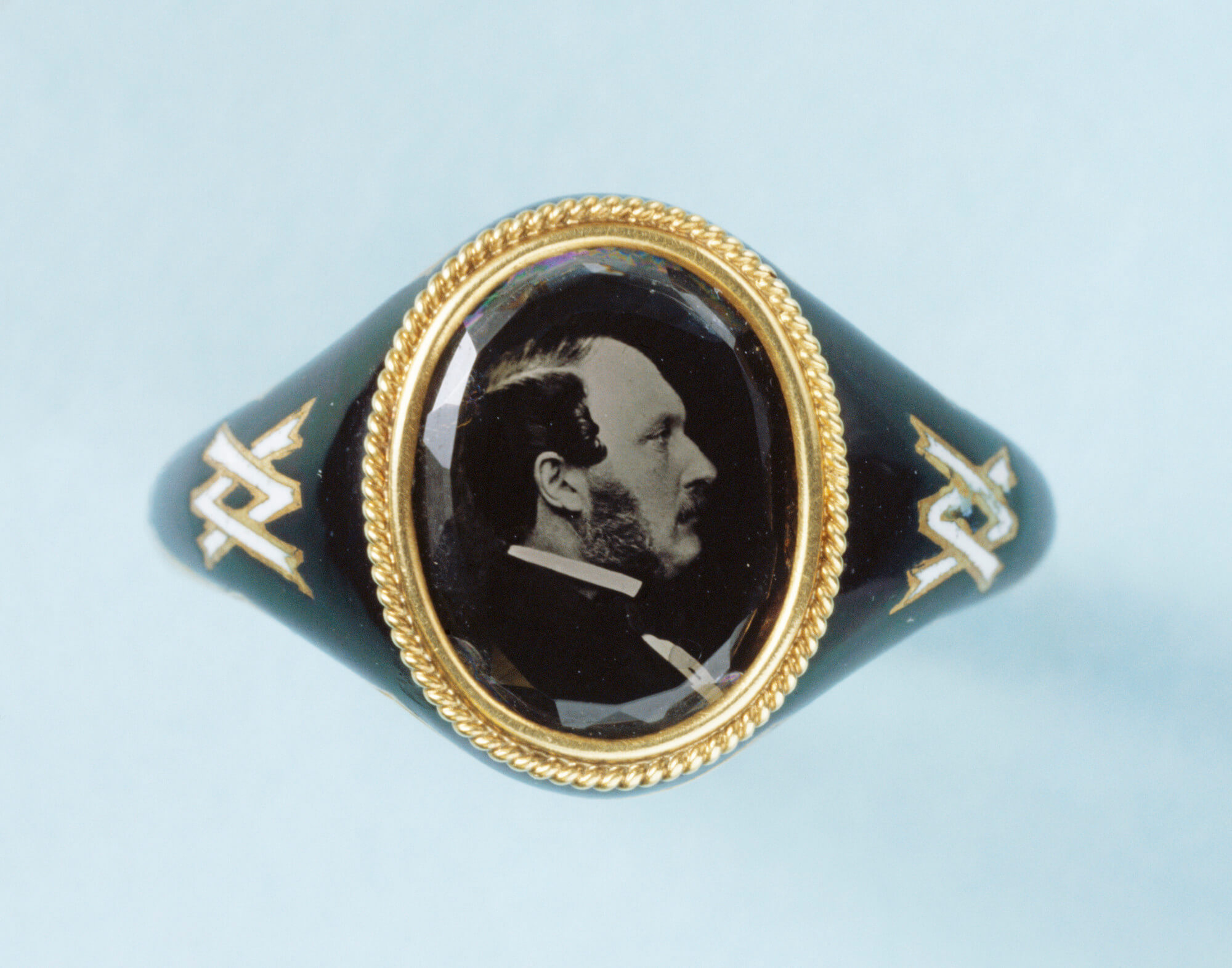 Memorial ring in gold and black enamel, the bezel containing a microphotograph, reversed, of the Prince Consort in 1861